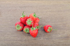 Ripe red strawberries on wooden table. Red strawberries on wooden table Stock Photos