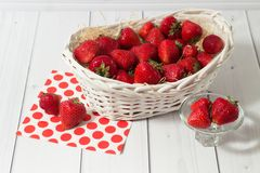 Ripe red strawberry in white basket Stock Images