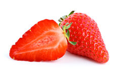 Ripe red strawberry. Whole and half Royalty Free Stock Photography