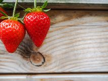 Ripe red strawberries on a wooden background stock photo