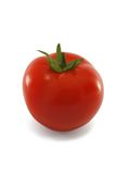 A ripe red tomato. With a green stalk, on a white background royalty free stock images