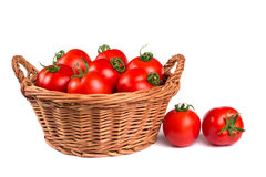 Ripe red tomatoes in a basket isolated Royalty Free Stock Images