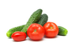 Ripe red tomatoes and cucumbers isolated on white background Stock Photos