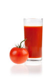 Ripe red tomatoes and glass of tomato juice. Royalty Free Stock Images