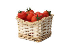 Ripe red tomatoes  isolated on a white. Ripe red tomatoes in a wattled basket isolated on a white background Stock Photography