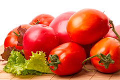 Ripe red tomatoes and lettuce Stock Photos