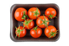 Ripe red tomatoes in plastic container isolated on white Stock Photo
