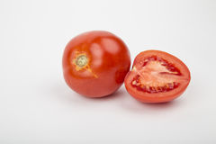 Ripe red tomatoes. On a white background Stock Image
