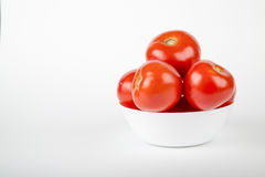 Ripe red tomatoes. On a white background Stock Photography