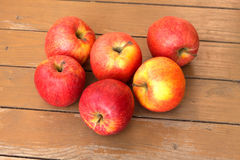 Ripe red and yellow apples on wooden floor closeup Royalty Free Stock Images