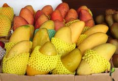 Ripe Red and Yellow Mangoes for Sale Royalty Free Stock Photos
