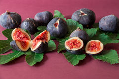 Ripe selected fig fruits on the berry color background. Stock Photo