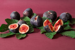 Ripe selected fig fruits on the berry color background. Stock Image