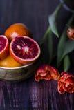 Ripe Sicilian orange slice on the table Stock Image