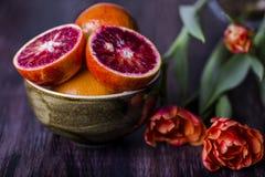 Ripe Sicilian orange slice on the table Royalty Free Stock Photo