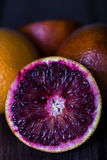 Ripe Sicilian orange slice on the table Royalty Free Stock Photos