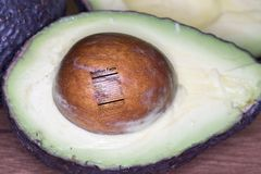 Ripe sliced avocado with nutrition label. Ripe avocado sliced in half with seed and nutrition fact label Stock Photo