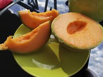 Ripe sliced cantaloupe with bright orange flesh. royalty free stock photos