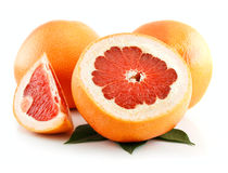 Ripe Sliced Grapefruit with Leaves Isolated Stock Photo