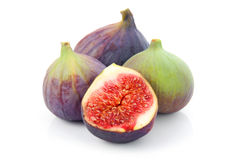 Ripe sliced purple and green fig fruit isolated Royalty Free Stock Images