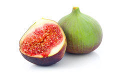 Ripe sliced purple and green fig fruit isolated Stock Photo