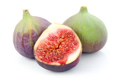 Ripe sliced purple and green fig fruit isolated Royalty Free Stock Image