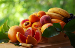 Ripe sliced toranja and various fruits Stock Photography