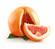 Ripe Sliced Wet Grapefruit with Leaves Isolated Royalty Free Stock Photography