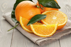 Ripe spanish oranges on wood table Royalty Free Stock Images