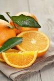Ripe spanish oranges on wood table Royalty Free Stock Photos