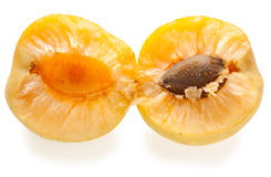 Ripe splitted apricot isolated on white Royalty Free Stock Photography