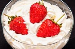 Ripe strawberrie in cream Stock Photos