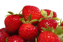 Ripe Strawberries. A pile of red, ripe, delicious strawberries on white stock images