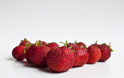 Ripe strawberries. Low angle view of ripe strawberries arranged in triangular shape Royalty Free Stock Images