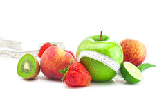 Ripe strawberries,apple,lime,peach,kiwi  and measu Stock Photography