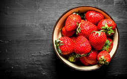 Ripe strawberries in a bowl. Stock Photos
