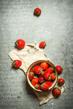 Ripe strawberries in bowl on old fabric. Royalty Free Stock Photography
