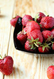 Ripe strawberries in a bowl on the table Stock Photography