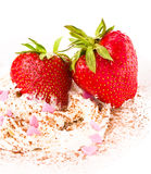 Ripe strawberries with cream on white background, decorated with Royalty Free Stock Photos