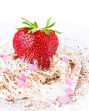 Ripe strawberries with cream on white background, decorated with Royalty Free Stock Images