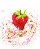Ripe strawberries with cream on white background, decorated with Stock Photo