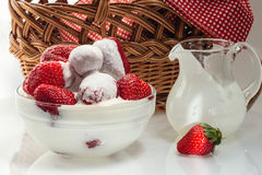 Ripe strawberries in a cup with milk cream. Ripe fresh strawberries in a cup with milk cream stock images
