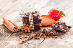 Ripe strawberries and dark chocolate, spices. royalty free stock photos