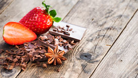 Ripe strawberries and dark chocolate, spices. Royalty Free Stock Image