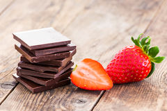 Ripe strawberries and dark chocolate, spices. Stock Photography