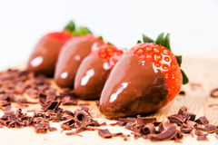 Ripe strawberries dipped in chocolate. Stock Image