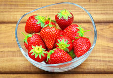 Ripe strawberries in a glass bowl Stock Images