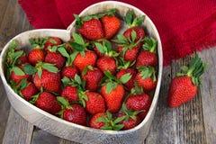 Ripe strawberries in heart dish Stock Photos