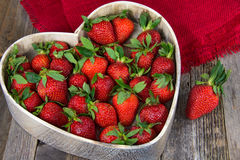 Ripe Strawberries In Heart Dish Stock Photos