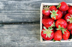Ripe Strawberries In Wooden Box On Wooden Table Stock Photo